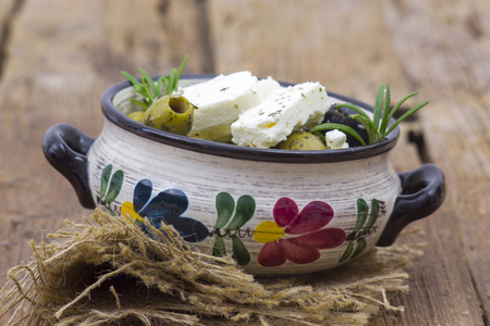 feta cheese and olives with herbs in olive oil Archivio Fotografico - 96607960