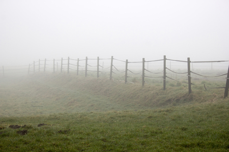 fence and fog Stock Photo