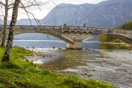 Old stone bridge on river Sava Bohinjka in Slovenia