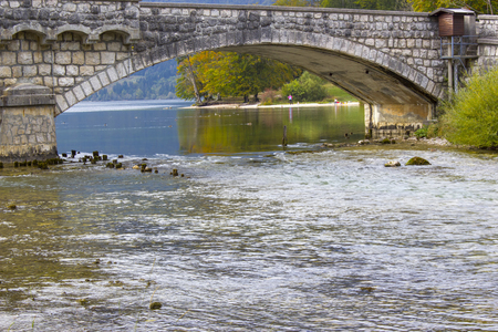 Old stone bridge on river Sava Bohinjka in Slovenia