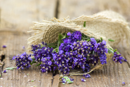 Bunch of lavender flowers on old wooden background Stock Photo