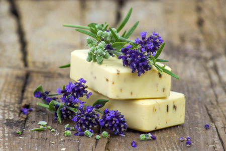 bars of natural soap and lavender flowers Stock Photo