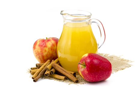 Apple juice and apple on white background