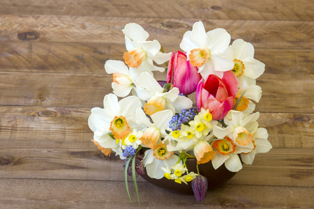 bouquet of spring flowers on wooden background