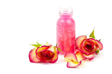 bath oil and pink roses Stock Photo