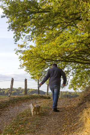 man walking with a dog in the forest Stock Photo