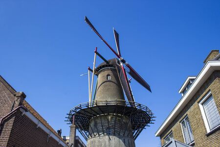Old traditional high wind mill in Zierikzee, historical town in Zeeland, Netherlands
