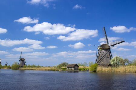 rural landscape with windmills at famous tourist site Kinderdijk in Netherlands. This system of 19 windmills was built around 1740