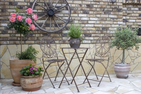 beautiful place in the garden in the mediterranean style, brick wall with grill Stok Fotoğraf