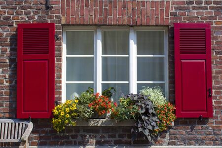 Old German house with window with wooden shutters, Wachtendonk, North-Rhine Westphalia, Germany