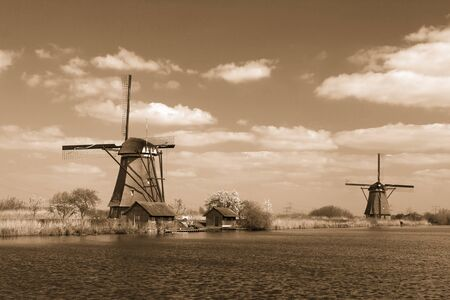 rural lanscape with windmills at famous tourist site Kinderdijk in Netherlands. This system of 19 windmills was built around 1740 and  heritage site 写真素材