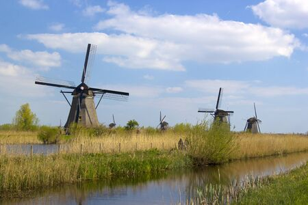 rural lanscape with windmills at famous tourist site Kinderdijk in Netherlands. This system of 19 windmills was built around 1740 and is a heritage site