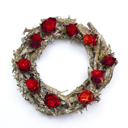 wooden wreath with red roses on white background