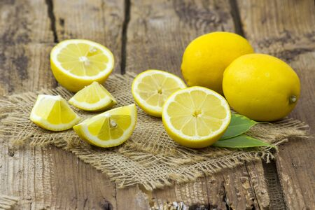 fresh lemon on old wooden background