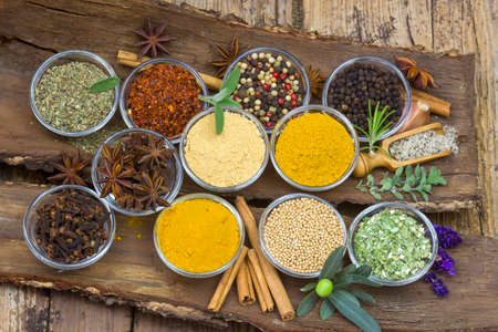 Variety of spices on wooden background 版權商用圖片