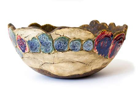 clay bowl on white background - handmade pottery 版權商用圖片