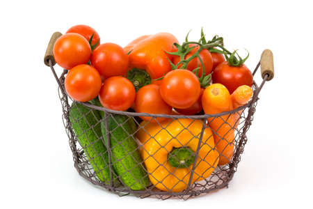 basket with fresh vegetables on white background