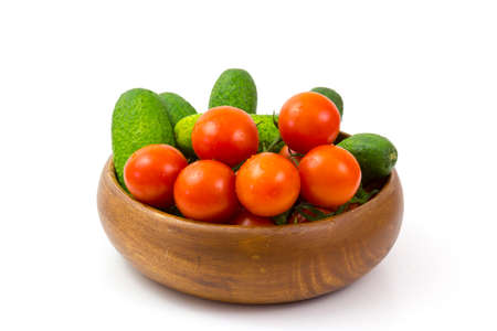 fresh vegetables in a bowl on white background