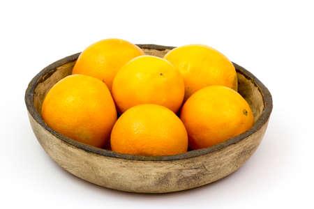 oranges in a clay bowl on white background Standard-Bild