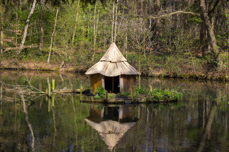 Wooden hut at the lake in summer in rural Germany Standard-Bild