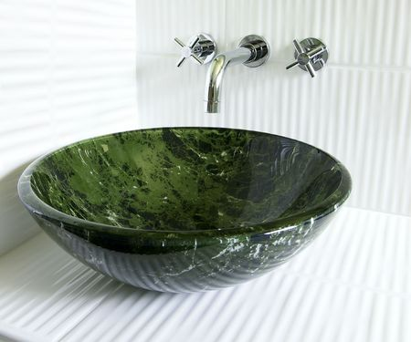 vessel sink: Modern renovated bathroom with tempered glass green marble imitation vessel sink and superb old style wall mount faucet on crisp white corrugated ceramic tiles.