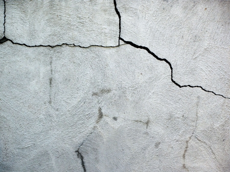Close up on damaged cracked house fondation made of cement blocks.