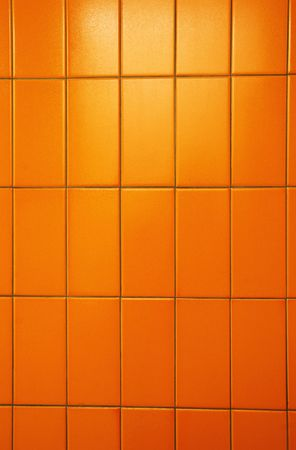 bathroom wall: Orange tiles of a public bathroom wall. Great color and tiles also have orange peel texture.