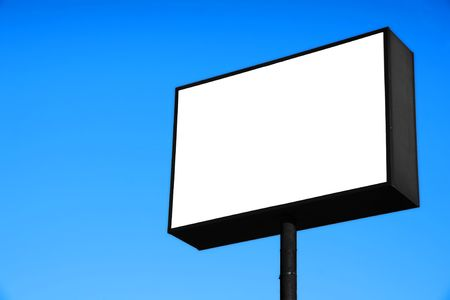 trafic: Large white blank road or freeway sign against pure blue sky, ready for advertisement. Stock Photo