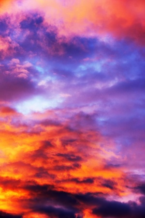 Inferno: sky on fire with deep orange and purple clouds, almost abstract background.