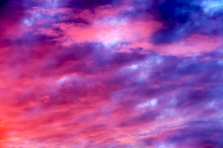Great sunset sky with clouds all possible shades of pink and purple, great nature background. Reklamní fotografie
