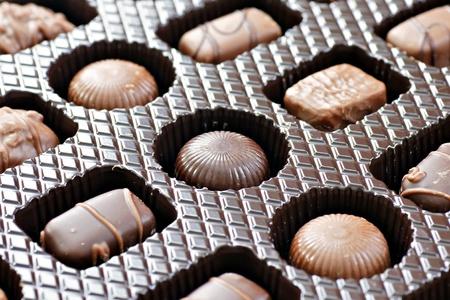 molded: Box of mixed shapes and dark or milk chocolates, at a diagonal.