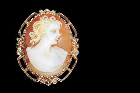 brooch: Fine jewelry: beautiful antique cameo on black background.
