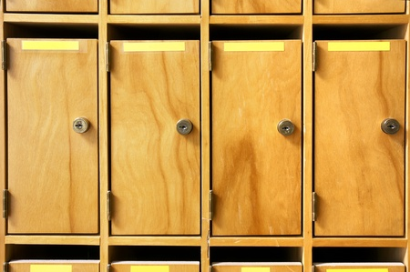 mailroom: Wooden mailboxes with metal lock in office building or school.