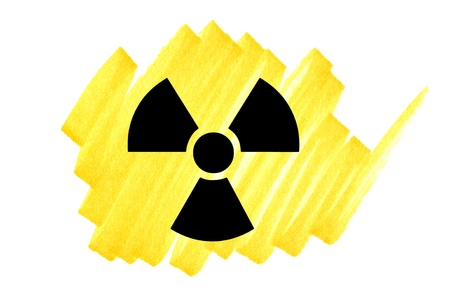 radioactivity: Radioactivity symbol in black on yellow ink marker scribble. Stock Photo