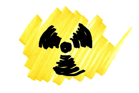 Radioactivity symbol in black and yellow ink marker scribble. photo