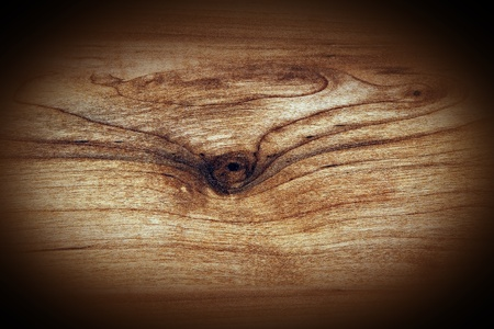 vignette: Hard wood plank with knot grungy background with dark vignette.