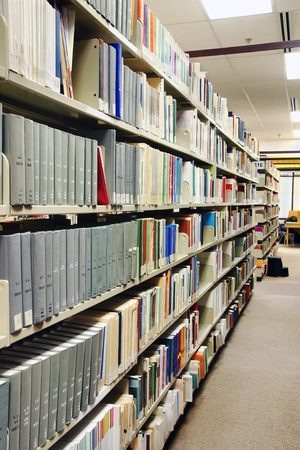 Perspective of rows of grey books at the school library, university or college. Stock Photo - 9154128