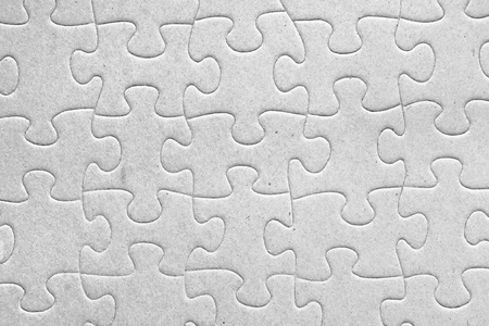 Unity:blank grey jigsaw puzzle pieces all connected, great details of textured cardboard material photo