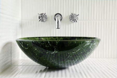 sink: Modern style greean marble vessel sink with wall mount faucets on bright white corrugated tiles.