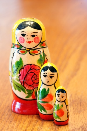 Generic russian nested dolls matrioshka with flowers painted on them on wood table