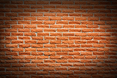 highlight: Another great brick wall background, orange terra cotta color, with follow spot highlight making a frame. Stock Photo