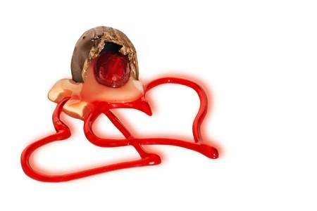 express feelings: Fun Valentines day or love card with two red gel heart shapes leaking out of an opened cherry milk chocolate candy on white background with shadows. Stock Photo