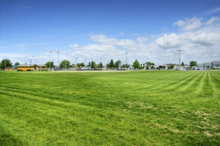 View from the center field position of a local outdoor baseball stadium on natural grass. Stock Photo