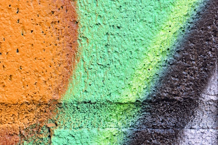 grafiti: Great urban concept background: macro detail of a colorful grafiti on brick wall and cement grout.
