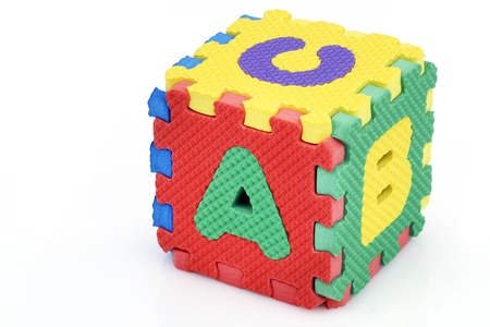 Fun colorful toy puzzle cube or dice in textured foam for kids to learn their alphabet, here a, b, c.