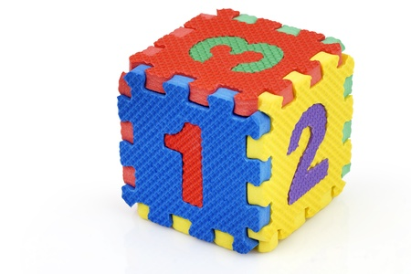 Fun colorful toy puzzle cube or dice in textured foam for kids to learn their numbers, here 1,2,3. photo