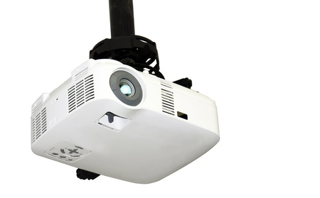 bolted: Close-up of a multi-media projector attached to the ceiling isolated on white background with copy space