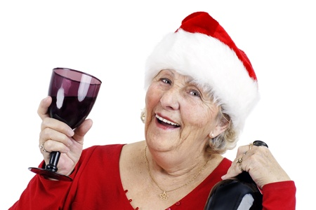 swell: Holiday concept: Grandma is having a swell time at the Christmas party drinking alcohol or wine and raising her glass to make a toast.