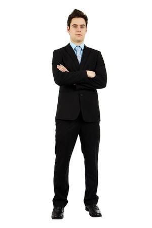 팔 비즈니스 정장에 잘 생긴 자신감 심각한 젊은 남자의 몸 전체 샷 넘어. 스톡 콘텐츠