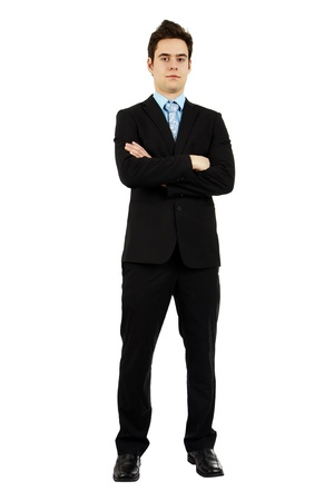 attire: Full body shot of an handsome confident serious young man in business suit with arms crossed.